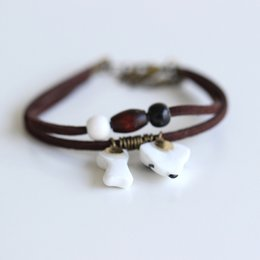Wholesale Dog Shaped Beads - Newly Bohemian Style Adjustable Handmade Brown Leather Bracelet Ceramic Dog And Bone Shape Bead Retro Loster Chain Gift For Lovers