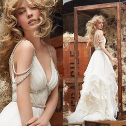 Wholesale Cross Bead Charms Cheap - 2016 New Summer Beach Boho Wedding Dresses Spaghetti Straps Beaded A Line Backless Criss Cross Tiered Charming Bohemian Bridal Gowns Cheap