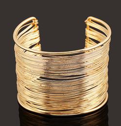Мода женщины браслет 18K золото / серебро цвет манжеты браслет девушки панк стиль браслет 10prs сплава браслет вокруг железа линии браслеты cheap silver line bangle от Поставщики серебряный браслет