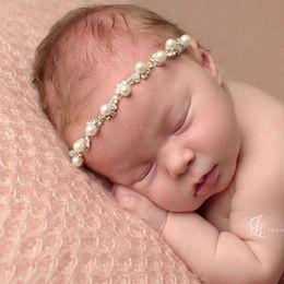 Wholesale Pearl Head Bands - Baby Girls Pearl Rhinestone Headbands Infant Elastic White Pearl Hairbands Head Band Children Hair Accessories Girls Wedding Headwear KHA351