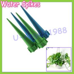 Vente chaude 40 pcs / lot automatique jardin cône spike arrosage des plantes fleur arroseurs système d'irrigation bouteille ? partir de fabricateur