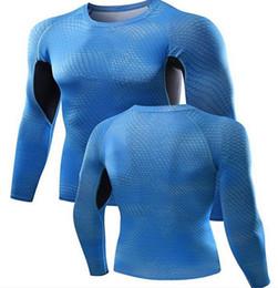 c50ae16bbf18e Macho de entrenamiento de manga larga fitness deportiva camiseta de alta  elasticidad de secado rápido