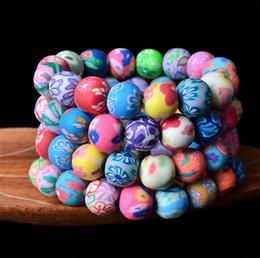 kinder perlen armbänder Rabatt Neue 12mm Polymer Clay runde Perle 50pcs Fashion Polymer Clay Armbänder böhmischen Perlen Armbänder, Kinder Geschenk Frauen Schmuck 2999