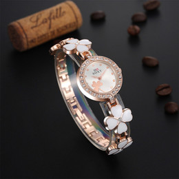 Wholesale Ceramic Form - Fine New Style Ms. explosion models Alloy bracelet watches ceramic watches female form female models Clover women GirlWrist Watch 2piece lot