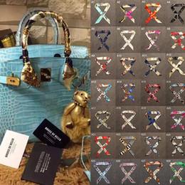 Multifuncional marca de luxo mulher cachecóis pequeno lenço bandage moda bolsa para Lady Silk Scarf bolsa cintas para cabeça de
