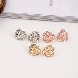 Wholesale Gold Heart Shaped Stud Earrings - New York Fashion Tone heart shape earrings hollowed-out stud earings jewelry brand jewellery for women girls Silver Gold Rose Gold