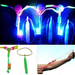 Wholesale Led Lighted Helicopter Wholesale - led toys 12Pc LED Light Flying Sling Helicopter Rocket Arrow Frisbee Flyer Boomerang Toys Truck led led lighting