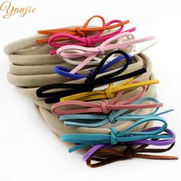 Wholesale Suede Headbands - Wholesale- 12 pcs lot 2016 New Faux Leather Bow Baby Girl Suede Elastic Nylon Headband Chic Hair Accessories For Kids Headwrap Headwear
