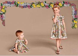 Wholesale Monsoon Flower Dress - Fashion Beauty WL Monsoon 2016 Girls Princess Floral Dresses Short Sleeve Kids Party Flower Dress New Summer Clothing