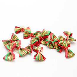 Wholesale christmas pet hair bows - 100pcs ot Cute Mini Handmade Pet Dog Christmas Hair Bows Assorted Christmas Pattern Cute Hair Accessories for Dogs