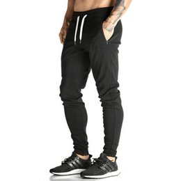 Wholesale Tights Men Thin - European And American Style Men Tight Workout Pants Thin Casual Jogging Pants Feet Cotton Solid Color Sports Pants