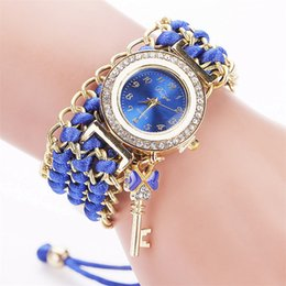 Wholesale Tan Belt For Women - Brand Women Gold Weave Hand Fashion Ribbon Watches Luxury Crystal Key White Analog Quartz Watch For Ladies wholesale