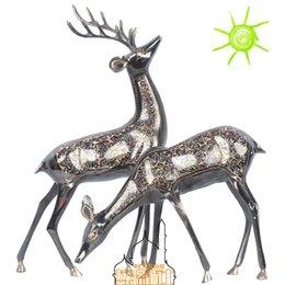 Ein Paar dekoratives Hochzeitsgeschenk des Messinghandgemachten Handwerks von Hauptlieferung Rotwild von Fabrikanten