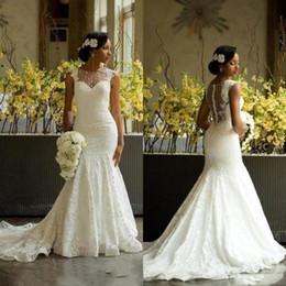 Erstaunliche hochzeitskleid luxus online-Luxus Afrikanische Meerjungfrau Spitze Brautkleider 2018 Erstaunliche Zurück Bedeckte Knöpfe Hochzeit Brautkleider Kapelle Zug