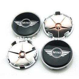Adesivo mini emblema del bottaio online-4 pezzi 68mm Car Styling Accessori Emblem Badge Sticker Mozzo ruota Caps Copertura centrale per MINI Cooper Tattoo Clubman Contryman