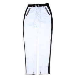 Calças de hip hop de zíper branco on-line-2017 melhor versão justin bieber branco preto splice listras calças dos homens hip hop bolso calças de pé Zíper Lateral calças Casuais S-XL