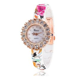 Wholesale Leather Studded Watch - Geneva free shipping Latest Geneva studded with diamond imitation ceramic lady's watch Geneva big female watch brand printing