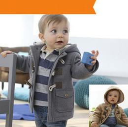 Niños bebés chaqueta nueva ropa de invierno 2 Color de abrigo capa gruesa ropa para niños Ropa para niños Con capucha caliente al por menor desde fabricantes