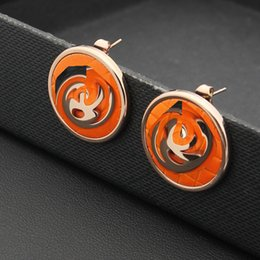 Pendientes de oro naranja online-2017 Moda doble C pendiente joyería al por mayor en blanco y negro naranja placa redondeada earnail 18 K Rose Gold Earrings