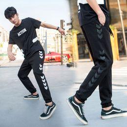 Wholesale Black Leggings Pockets - US Size Korean Style Men Harem Pants Leggings Jogger Pants Side Arrow Printed Black Joggers Men Casual Pants Men Sportwear