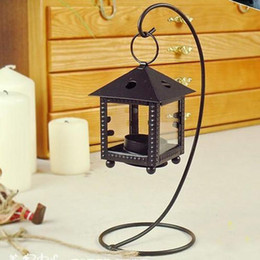 Wholesale Candle Hurricane Lamps Wholesale - Cozy cottages European Morocco hurricane lamp candle holder ornaments vintage wrought iron candlestick wedding gift ideas 160311#
