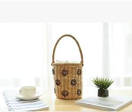 Wholesale Korean Straw Beach Bags - 2017 European fashion Korean embroidery all-match cute smile hand woven straw beach bag leisure Bucket Bag free shipping
