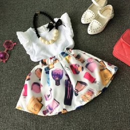 Wholesale Cute Skirt Outfits - 2016 Summer Toddler Kids 2-7T Girls Outfits Clothes Sleeveless T-shirt + Perfume Print Skirt Dress Cool 2PCS Set without necklace K7185