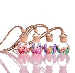 Chiaro ornamentale online-Bottiglia vuota di argilla polimerica vuota bottiglia vuota 8ML profumo di olio essenziale bottiglia di vetro trasparente coperchi in legno cap auto decorazione mix design ornamentale