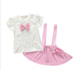 Wholesale Suspender Skirts Sets - summer newborn sets girls cute dot Bow cotton Top+Suspenders skirt 2pcs children suits kids short sleeve tees 0-7Y 1set pack XZT002