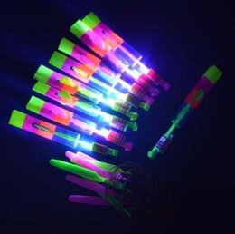 Wholesale Lead Shot Wholesale - LED Light Flash Amazing Flying Elastic Powered Arrow Sling Shoot Up Helicopter Rubber Band Umbrella Kids Flying Toys CCA7450 10000pcs