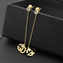 Wholesale hanging stud - 2017 Titanium earrings jewelry wholesale diamond single hanging hollow G pattern Earrings Korean Earrings
