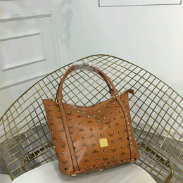 Wholesale Designer Real Leather Tote Bags - famous brand fashion women bags lady Real leather handbags Designer brand Rivet bags SN#MC32 purse shoulder tote Bag female 33CM With Straps