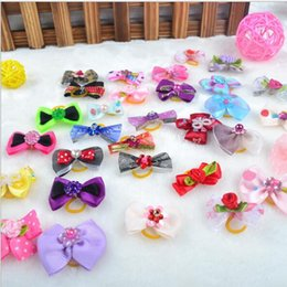 Wholesale Cute Dog Wedding - Rhinestone Pearls Style Dog Bows Head Pet Bows Dogs Hair Accessories Grooming Products Cute Gift New Products Mix Designs 2016