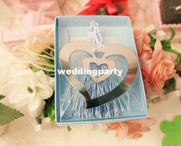 Argentina La boda favorece los regalos del acero inoxidable de plata que declina el tabique hermético doble del corazón con la borla blanca Suministro