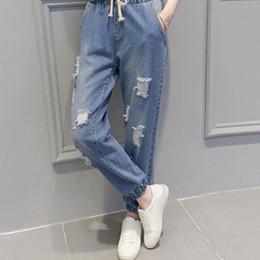 Wholesale- 2017 autumn and summer new elastic waist jeans female Korean  hole feet harem pants students women loose wild pants S2252 d3c682c5209c