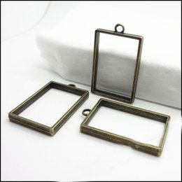 Wholesale Rectangle Pendant Trays - 20PCS Vintage Antique Bronze Photo Frame Hollow rectangle Charms Pendant tray Base Setting Cabochon Cameo Pendant 37x23mm