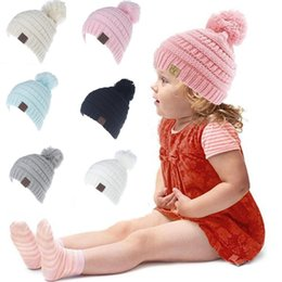 Wholesale knitted hats for girls - Kids CC Knitted Beanie Hat With Ball For Winter FashionBrand CC Children Girls Boys Warm Casual Beanies Caps For 2-6Y Kids YYA485