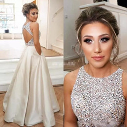 Wholesale vintage beaded top sleeveless - Sparkle Crystals Beaded Top Satin A Line Prom Dresses 2018 New Jewel Neck Open Back Floor Length Evening Gowns with Pockets