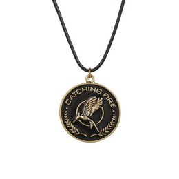 Wholesale Hunger Fire - Vintage Alloy The Hunger Games mockingbird round Lettering catching fire Wheat ear crow Necklace Firebird Pendant bird Necklace boy x353