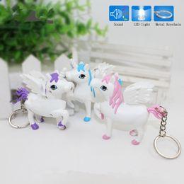 Wholesale Toy Car Lights - New unicorn LED Keyring with sound Children Toys Christmas gift lovely cartoon animal Led keychain bag car pendant Q0181