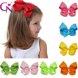 Wholesale Bow Knot Hair - Wholesaler 4 inch Knot centre Baby Girls Solid Grosgrain Ribbon Hair bows With Alligator Clips CPSIA items