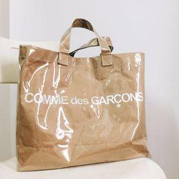 Wholesale Vegetable Fashion - Double Transparent Black Handbag Kraft Paper Shopping Bag Fashion High Capacity PVC Bags Letter Waterproof Beach Travel HFBB011