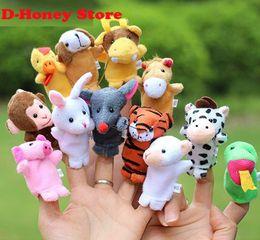 Brinquedos chineses de pelúcia on-line-Zodíaco Chinês 12 pçs / lote Animais Dos Desenhos Animados Biológico Fantoche de Dedo Brinquedos de Pelúcia Bonecas Criança Bebê Favor Dedo Boneca Frete grátis