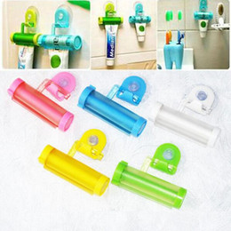 Wholesale Toothpaste Tube Holders - New Colorful Plastic Tube 5 Color Rolling Toothpaste Squeezer Dispenser Hook Holder Sucker Hanging Bathroom Wall