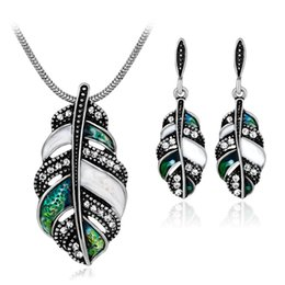 Wholesale Feather Diamond Earrings - Vintage Bohemian style feather jewelry sets personality feather alloy insert diamond epoxy lady necklace earrings two pieces per sets CA556