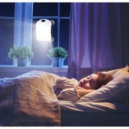Sensor de luz solar portátil online-Hot Portable 2 en 1 Lámpara PIR Solar con banco de energía de ventana 6000 mAh Mosquetón Ventosa Ventana palo Cargador solar LED sensor Luz nocturna