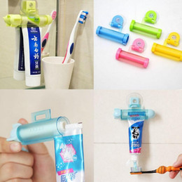Wholesale Toothpaste Tubes Wholesale - New Fashion Creative Rolling Squeezer Toothpaste Dispenser Tube Partner Sucker Hanging Holde distributeur dentifrice 5 Colors