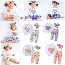 Wholesale Heart Shaped Headbands - Baby INS heart-shaped flower outfits Kids Casual long sleeve T-shirts+pants+Bow headband 3pcs sets Floral pajamas Clothing Sets C2676