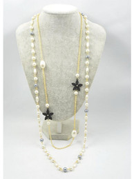 Wholesale Pearl Loop - New fashion white black camellia pearl Necklaces Delicate Europen and America Loop long Sweater Chain bride pearl Necklace ZZS105