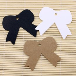 Wholesale Paper Wedding Bookmarks - 6*5cm Bowknot Kraft Paper Clothes Price Hang Tags Wedding Party DIY Cards Xmas Gift Wrap Label Bookmark Blank Hand Luggage Tag